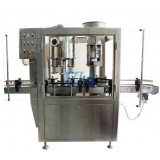 AUTOMATIC WINE FILLING, CORKING, CAPSULING AND LABELING SYSTEM